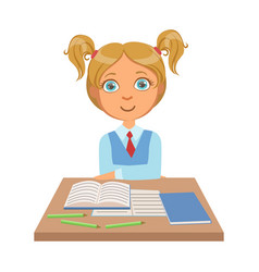 Little schoolgirl sitting at the desk with vector