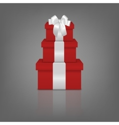 Stack of three realistic red gift boxes with white vector