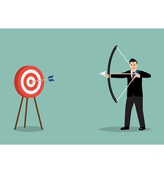 Businessman hitting the target vector