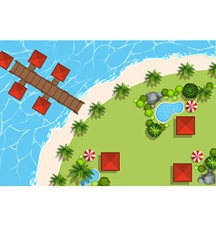 Aerial scene of huts and beach vector