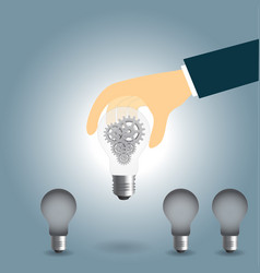 hand keep up idea concept with gear in light bulb vector image vector image