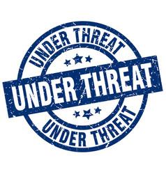 Under threat blue round grunge stamp vector