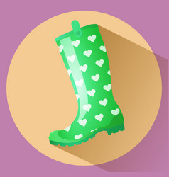 Green classic gumboot with white hearts pattern vector