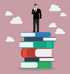 Businessman standing on stack of books with a vector