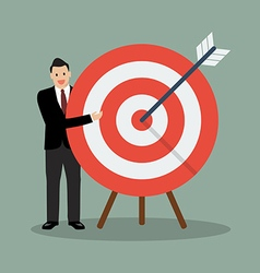 Businessman pointing to the big target vector