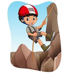 Boy climbing up the mountain vector image