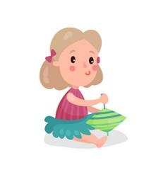 sweet blonde little girl sitting on the floor vector image vector image