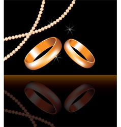 golden wedding rings and pearl beads vector