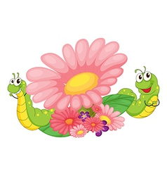 Smiling worms and blooming flowers vector image