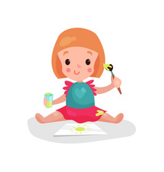 sweet redhead little girl sitting on the floor vector image vector image