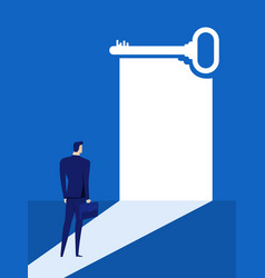 Businessman looks at the key door of success vector