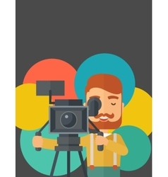 Videographer and his video cam with stand vector