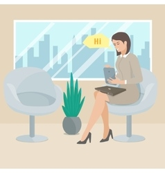 Business woman sitting in a chair with the tablet vector image vector image