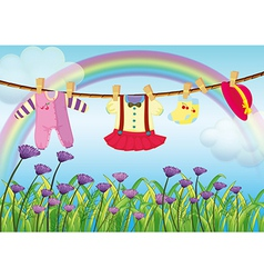 Hanging baby clothes near the garden with fresh vector image
