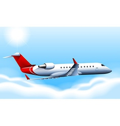 A cruising plane in the sky vector