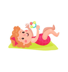 adorable little girl lying on her back playing vector image vector image