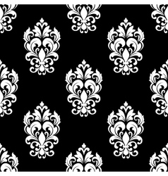 Seamless pattern with floral motifs vector