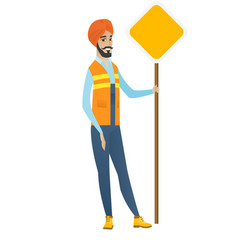 Young hindu road worker showing road sign vector