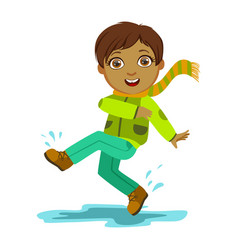 Boy kicking water with foot kid in autumn clothes vector
