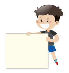 happy boy holding white board vector image