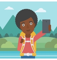 Woman with backpack making selfie vector