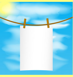 Paper mock up hanging on the rope with wood pins vector