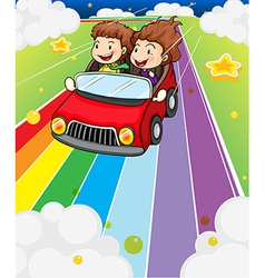 Two kids riding in a red car vector image vector image