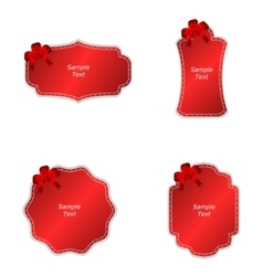 A set of four tags with red bows on a red vector