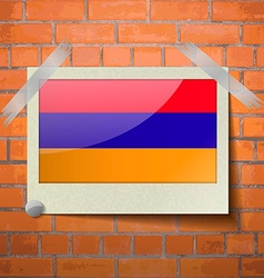 Flags armenia scotch taped to a red brick wall vector