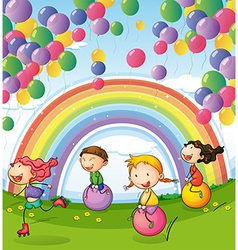 Kids playing with floating balloons and rainbow in vector