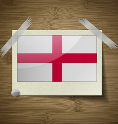 Flags england at frame on wooden texture vector