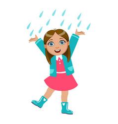 Girl dancing under raindrops kid in autumn vector