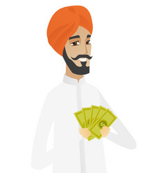 Happy hindu businessman holding money vector