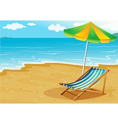 A seashore with a bench and an umbrella vector