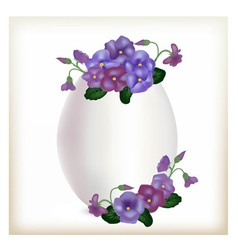 Egg with flowers of violets vector