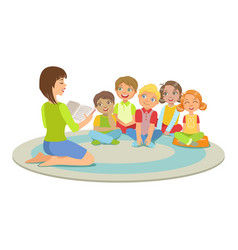 Group of small kids sitting around the teacher on vector
