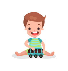 sweet little boy sitting on the floor playing with vector image vector image