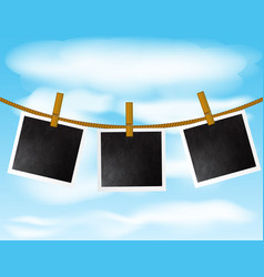 Set of blank photo frames hanging on the rope with vector