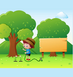 boy watering flowers in the park vector image