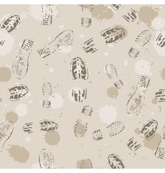 Grange seamless background with footprints vector image
