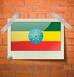 Flags ethiopia scotch taped to a red brick wall vector