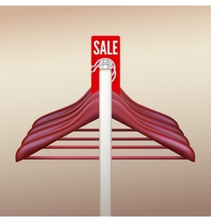 Clothes hangers with a sign Sale vector image