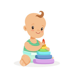 Cute smiling baby sitting and playing with pyramid vector