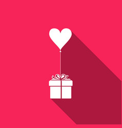 Gift with balloon in shape of heart vector
