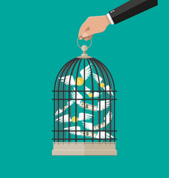 Hand holds cage with flying money vector