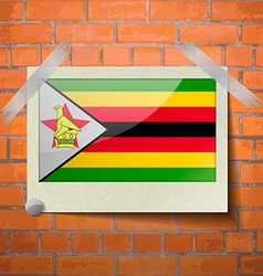 Flags zimbabwe scotch taped to a red brick wall vector