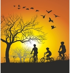 Family cycling in the countryside at sunset vector