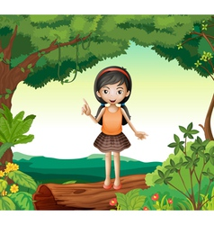 A girl standing on wood in nature vector image vector image