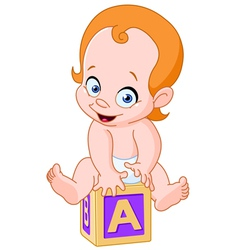 Baby on alphabet cube vector image vector image