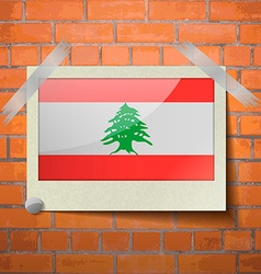 Flags lebanon scotch taped to a red brick wall vector
